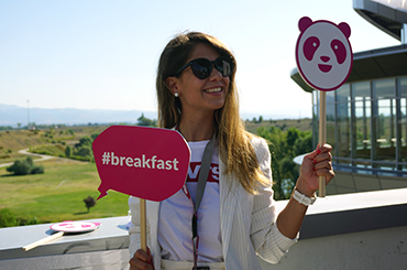 photo of milena holding panda logo and breakfast sign