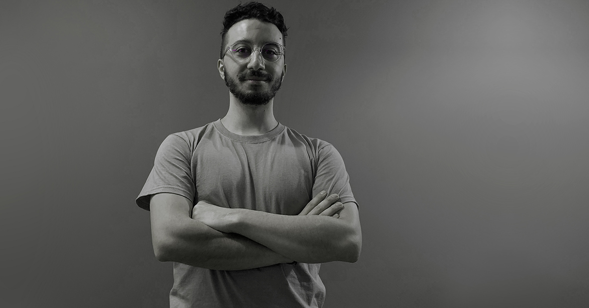 a black and white photo of bogomil, a telerik academy alpha javascript graduate in front of a grey wall