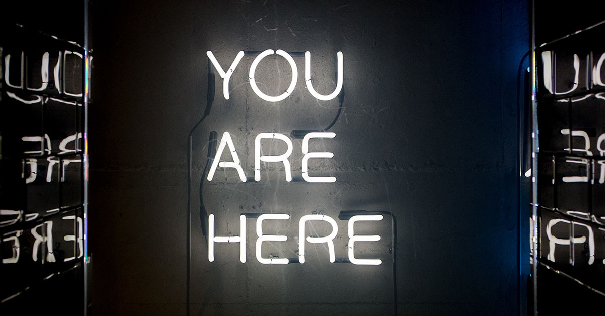 A neon sign you are here