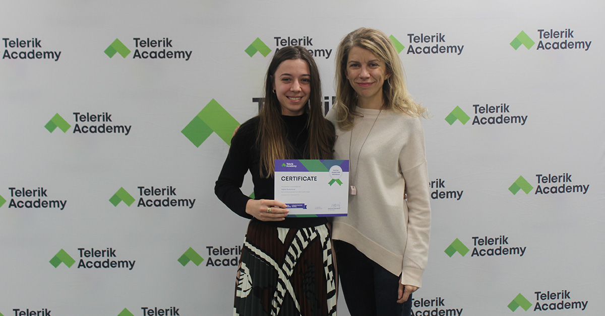Kalina and Ina Toncheva, program's lead trainer, in front of panel with Telerik Acacemy's logo during graduation